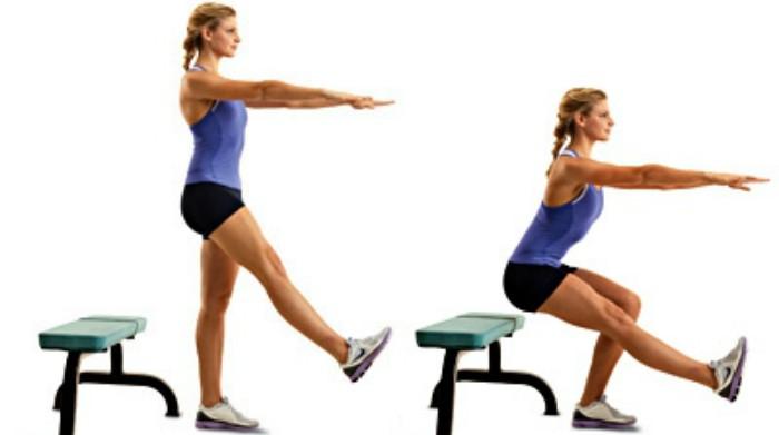 bài tập đứng lên ngồi xuống bằng một chân giúp gia tăng sức mạnh cơ đùi và cân bằng năng lượng dư thừa trong cơ thể; đây là phương pháp giảm cân siêu tốc cho vòng 3 của bạn. Cô gái đang thực hiện động tác đứng lên ngồi xuống bằng một chân giúp giảm cân h iệu quả và có một sức khỏe dẻo dai.