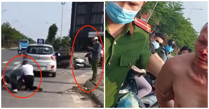 Đại úy công an Nguyễn Thanh Lâm đứng nhìn điện thoại khi tài xế taxi vật lộn với tên tội phạm