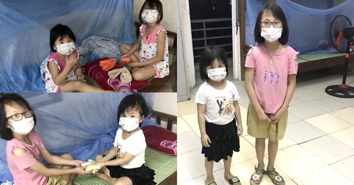 Hình ảnh của Tuyết và Mai - hai cháu bé có cha mất liên quan Covid-19, tự chăm sóc nhau trong khu vực cách ly ở Bắc Ninh